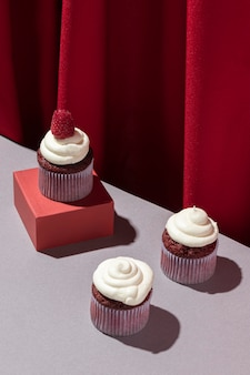 High angle delicious cupcakes with raspberry
