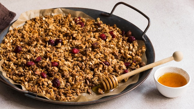 High angle of delicious muesli with honey