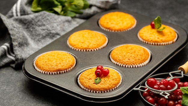 High angle of delicious muffins with berries in pan