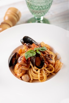 High angle of delicious pasta with sea food Free Photo