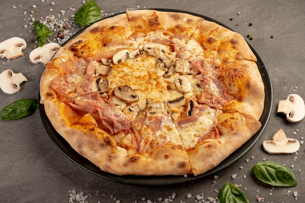 High angle of delicious pizza with mushrooms