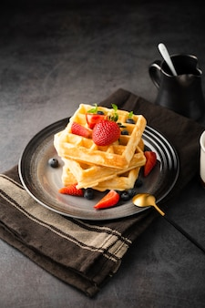 High angle delicious waffles with fruits