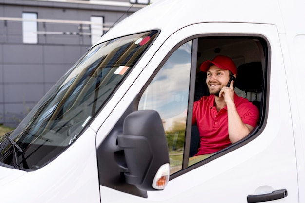 High angle delivery service man talking over phone