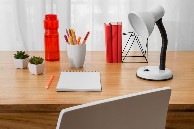High angle desk arrangement with notebook