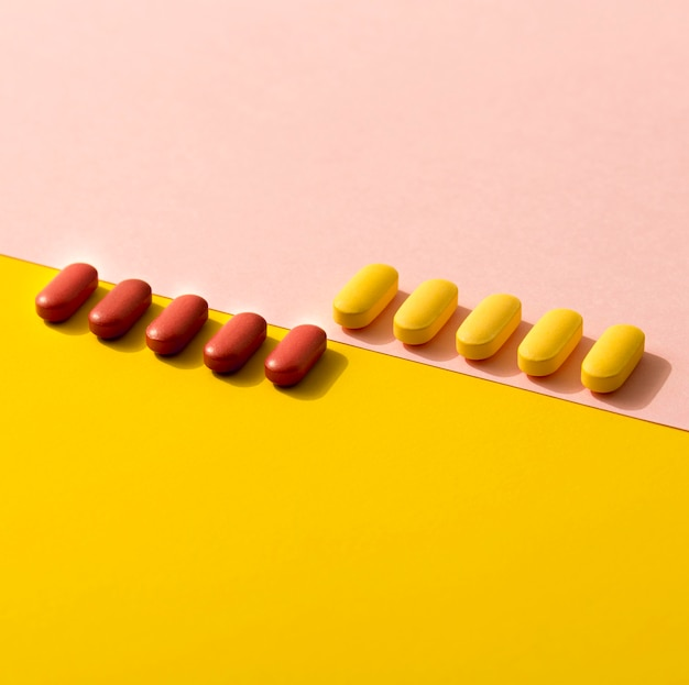 High angle of differently colored pills in rows
