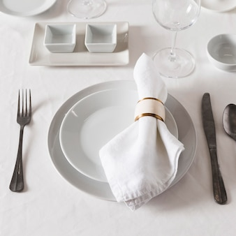 High angle of dinner table setting for hanukkah with multiple plates and cutlery
