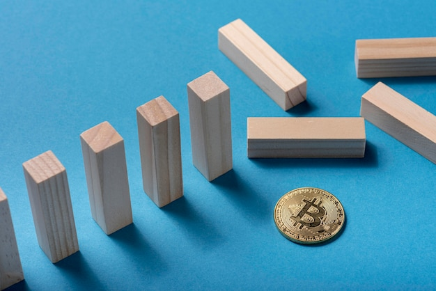 High angle of domino pieces with bitcoin