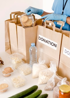 High angle of donation bags with food