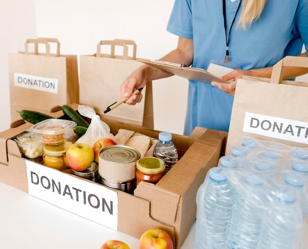 High angle of donation box and bags with food
