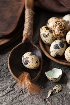 High angle of easter eggs with broken shells and wooden spoon