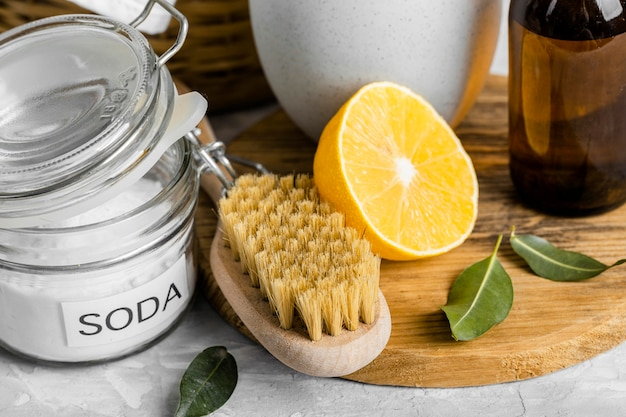 High angle of eco-friendly cleaning brush with lemon and baking soda