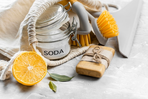 High angle of eco-friendly cleaning brushes with lemon and baking soda