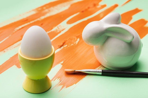High angle eggs with watercolor orange strikes