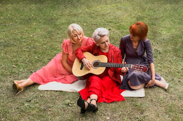 High angle elderly women playing music