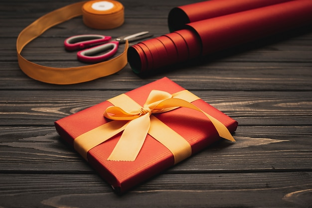 High angle of elegant christmas present with wrapping paper