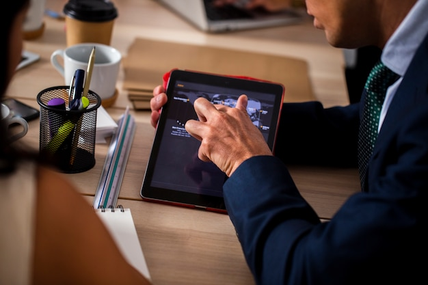 High angle employees using tablet
