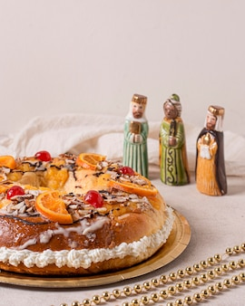 High angle epiphany day food with miniature holy characters