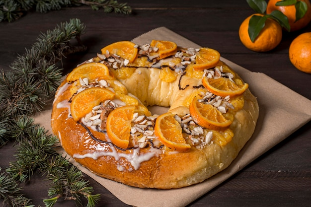 High angle epiphany day food with sliced oranges