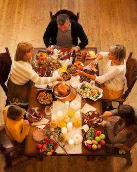High angle family sitting at dinner table