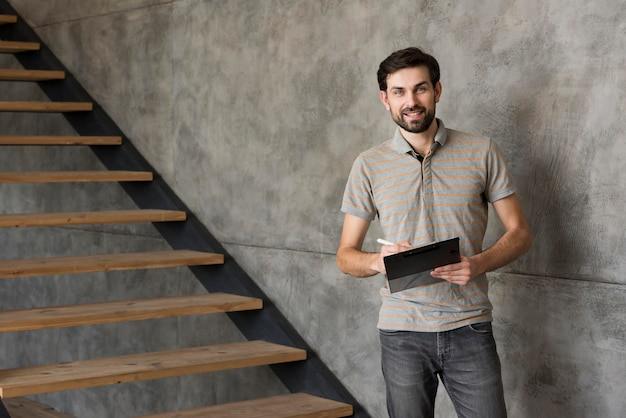 High angle father at home with tablet