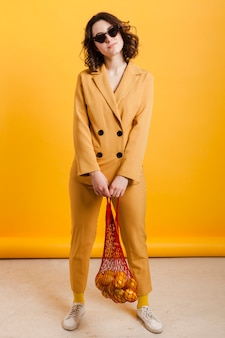 High angle female carrying lemons