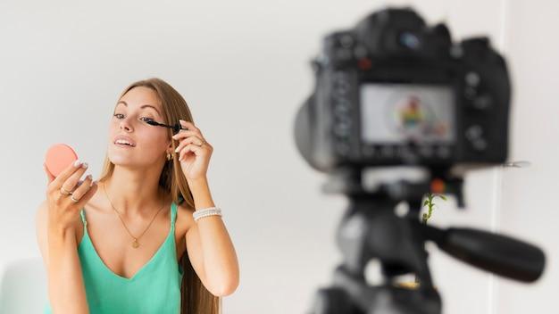 High angle female recording makeup tutorial