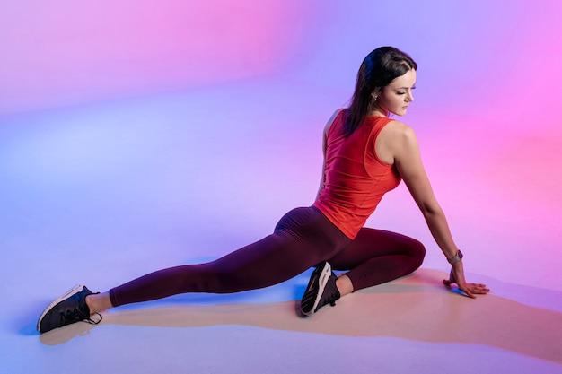 High anglefemale stretching
