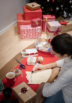 High angle female writing letter for santa claus