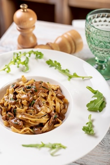High angle of fettuccine pasta on wooden table Free Photo