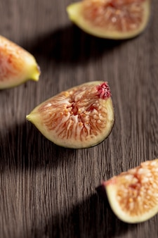 High angle of fig slices on wooden surface