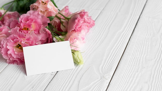 High angle of flowers with blank card