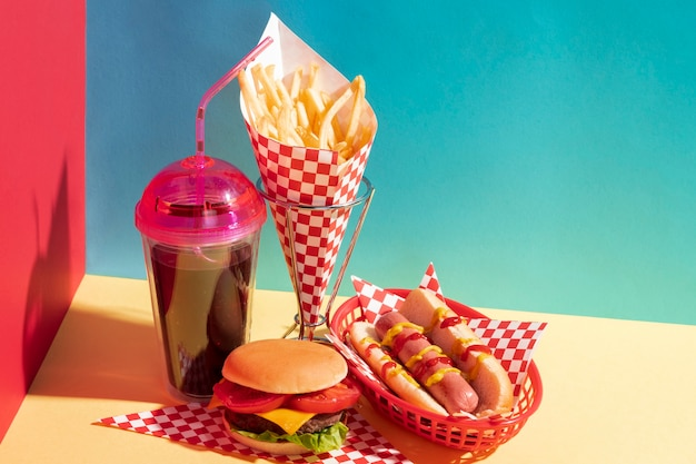 High angle food arrangement with juice cup and cheeseburger