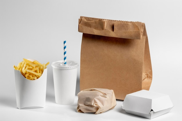 High angle food in blank packaging with paper bag