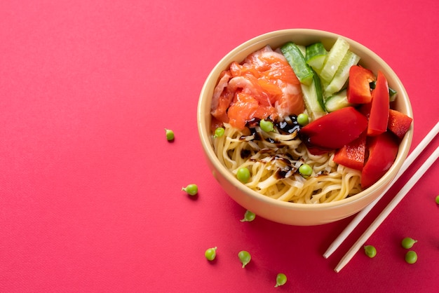 High angle food bowl and chopsticks