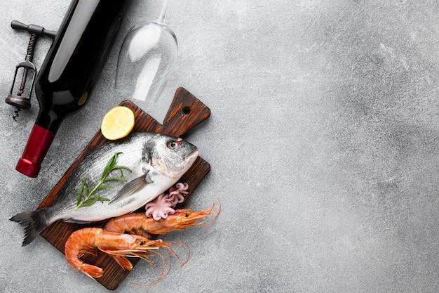 High angle fresh seafood with wine