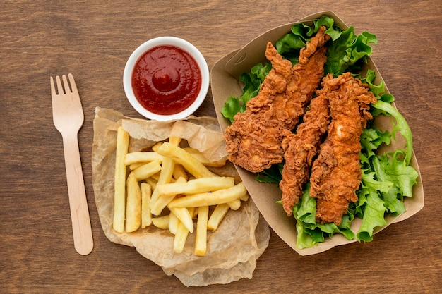 High angle fried chicken and fries with ketchup