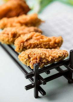 High angle fried chicken pieces on tray