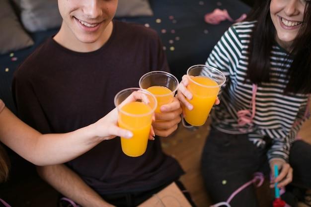 High angle friends toasting soda