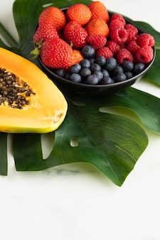 High angle of fruit bowl with papaya