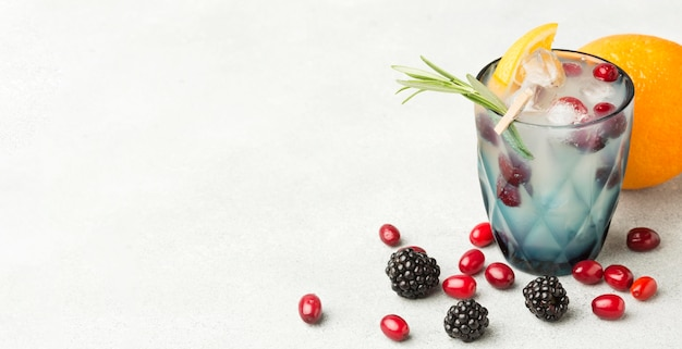 High angle of fruit cocktail glass with copy space