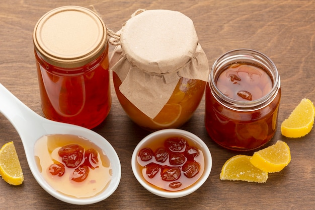 High angle fruit jam in jars and bowl