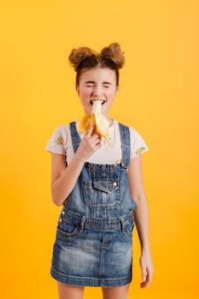 High angle girl eating banana