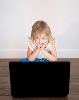 High angle of girl looking on laptop