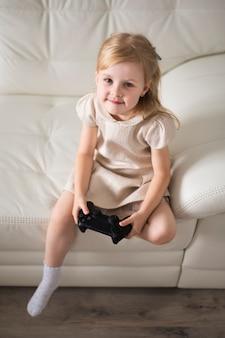 High angle girl playing with joystick