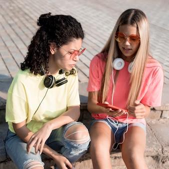 High angle girls with headphones