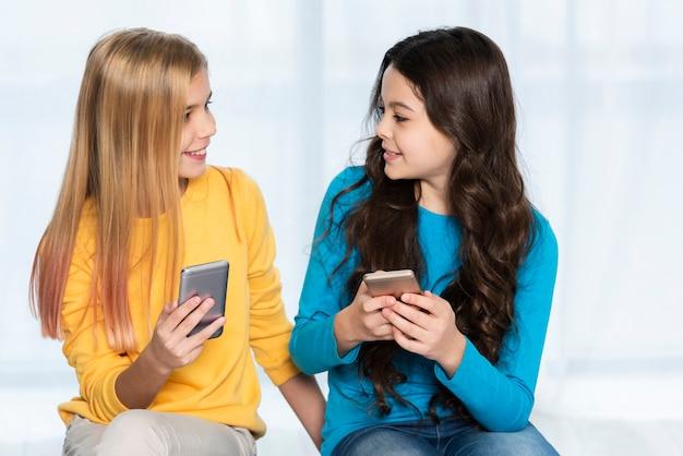High angle girls with mobile