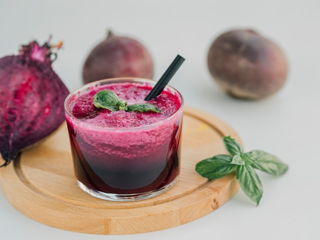 High angle glass with beetroot huice