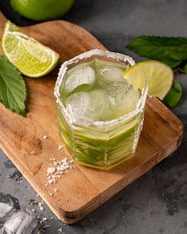 High angle glass with lime and ice