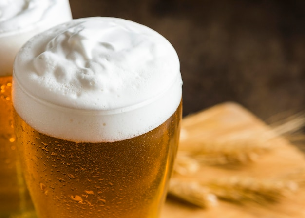 High angle of glasses of beer with foam