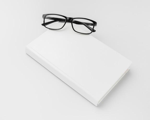High angle glasses beside book
